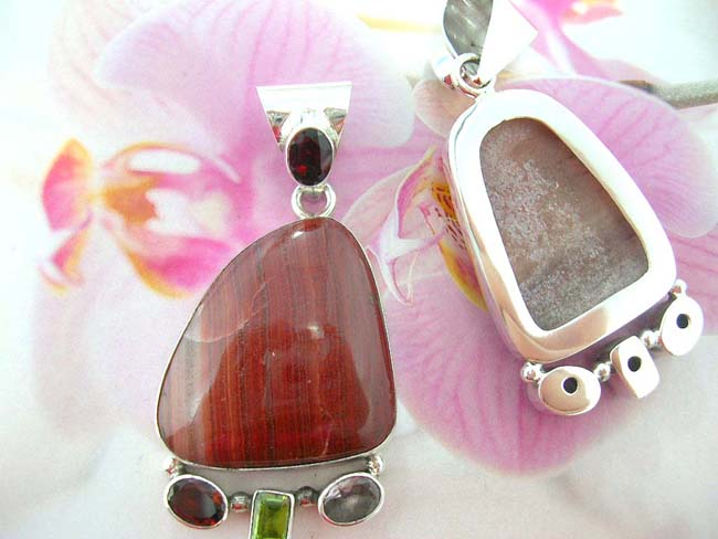 Designer jewelry distributor imports gemstone pendant with crystals at bottom on 925. sterling silver frame