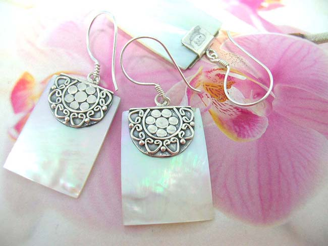 Indonesian art wear boutique dealer supplies Floral and heart designed 925. sterling silver mounted earrings with opalescent gems