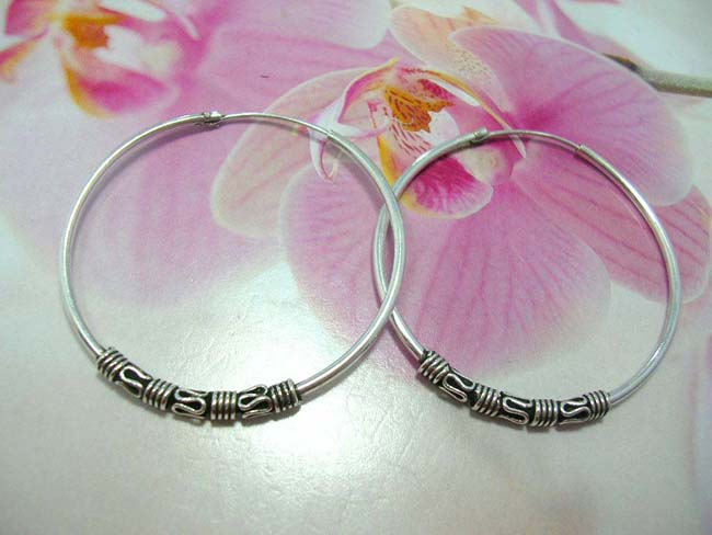 Wholesale accessory outlet supplier, Bali designer wear hoop earrings with four coil and snaky design, made from 925. sterling silver