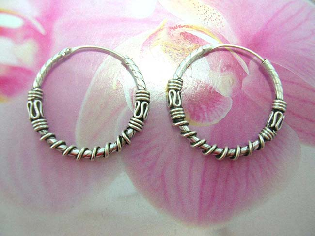 TRendy wholesale accessories online, Handcrafted sterling silver hoop earrings with wrap around cord design and snake style motif