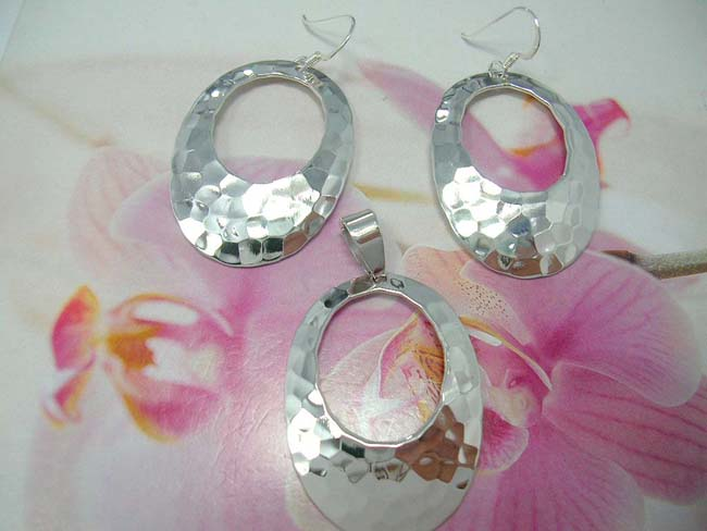Modern sterling silver earring and pendant set in cut out oval design from indonesian export company