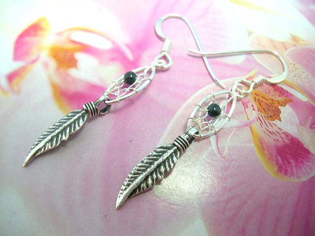 Oval dream catcher with black bead earrings holding two feathers. Native crafted from 925. sterling silver , Indonesia accessory shopping exchange