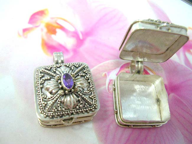 International bali jewelry outlet. Amethyst crystal embedded in 925. sterling silver locket decorated in bead and flower design