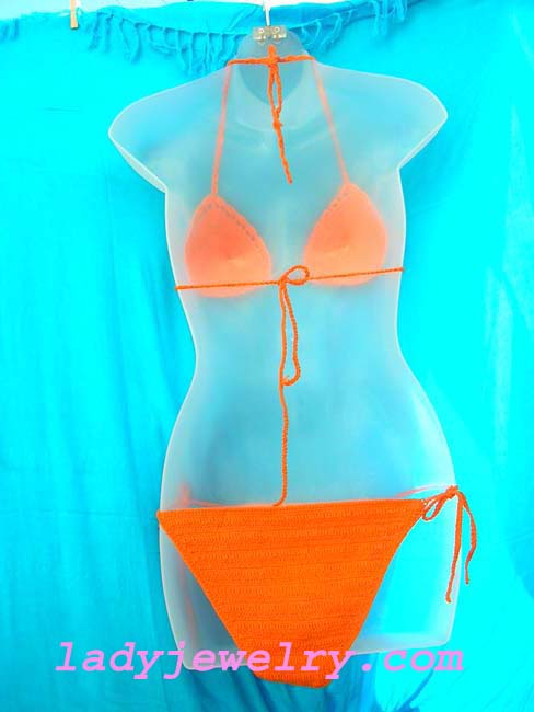 Holiday travel wear clothing outlet. Sexy orange batik beach bikini with crafted beads and sequin flower design