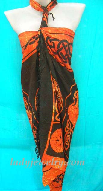 Fashion beach accessories online shopping. Celtic art designed bali sarong in orange and black