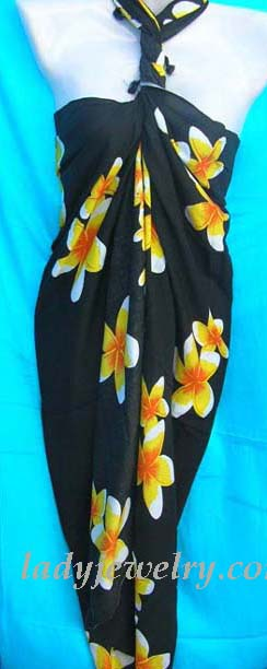 Tropical casual wear supply catalog. Artisan wear beach wrap in black with yellow floral design
