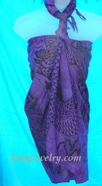 Premier resort apparel boutique retailer. Contemporary artist inspired print on purple leisure summer sarong