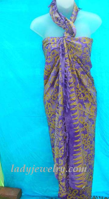 Hawaiian island resort wear supplier. Yellow spring flower pattern on purple beach sarong dress