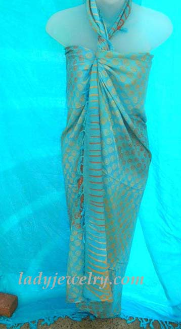 High style summer apparel fashion retailer. Silver spiral adorned, aqua blue beach sarong